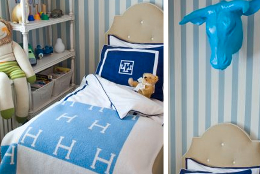 Animal head, tufted headboard and other boy's bedroom decor ideas via lilblueboo.com