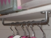 Random Household Tips: Turn a towel rack upside down for hanging storage at Tara's Bit of Whimsy via lilblueboo.com