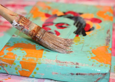 How to make a distressed folk art-style painting. DIY tutorial thin layer of step 1 via lilblueboo.com