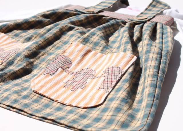 The Paper Doll Dress pocket applique via lilblueboo.com