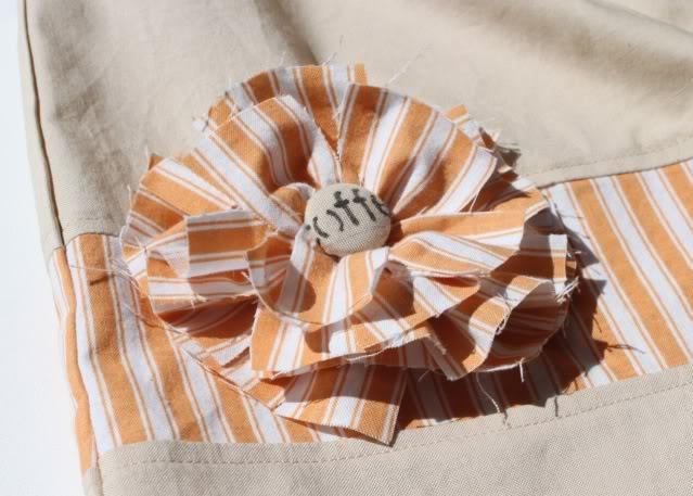 A Coffee Sack Dress mattress ticking and a flower via lilblueboo.com