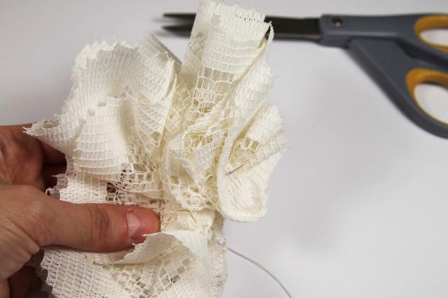 Make a vintage inspired hair clip using a dollar doily. DIY Tutorial via lilblueboo.com
