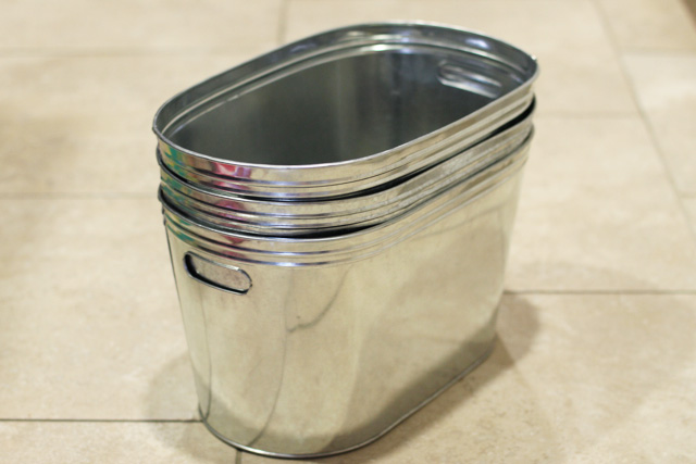Hanging metal bins via lilblueboo.com
