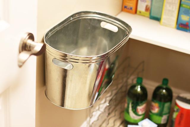 Attaching metal bin to wall in pantry via lilblueboo.com