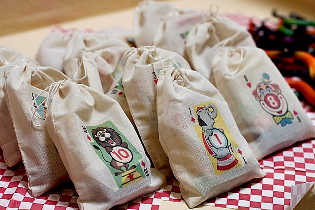 Circus playing card muslin party favor bag via lilblueboo.com