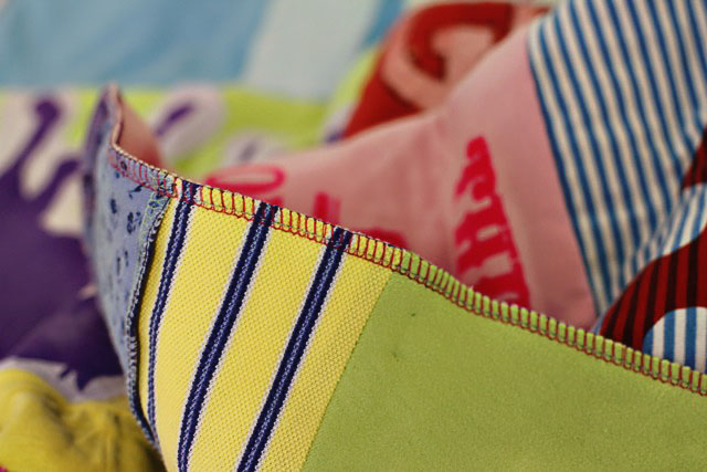How to make a memory quilt from baby blankets, clothes and t-shirts. DIY tutorial 25 via lilblueboo.com