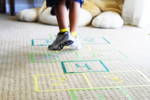 Outdoor and indoor games for kids DIY tutorial hopscotch via lilblueboo.com