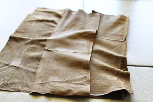 DIY Suede Fringe Bag (sewing the 2nd layer of fringe) via lilblueboo.com