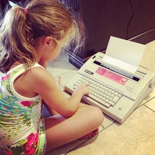 Boo and her typewriter via lilblueboo.com