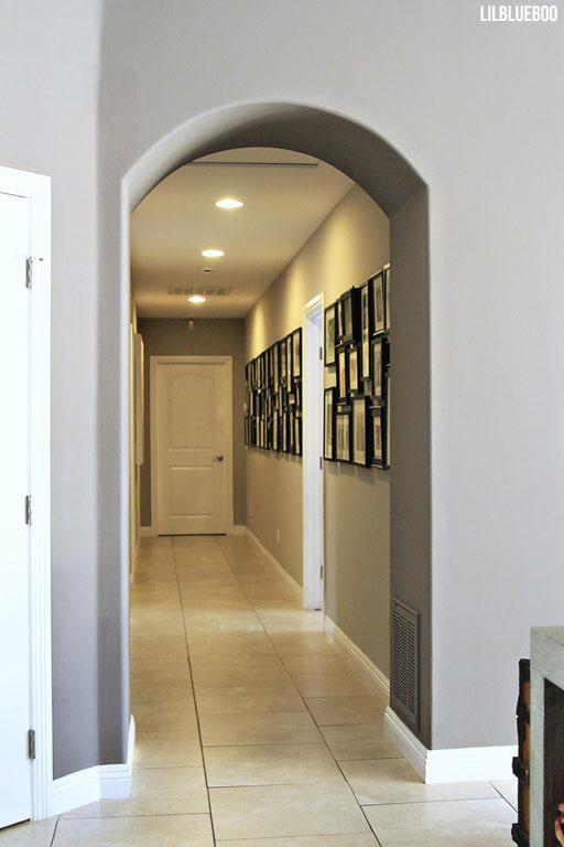 The photo wall down the hall (living room tour) via Ashley Hackshaw / Lil Blue Boo #homedecor #photography #photowall #office #diy