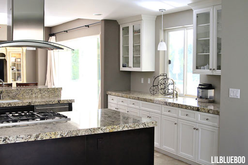 Kitchen makeover ideas pictures - I bought discount satin nickel and rubbed bronze knobs and pulls in discount packs  - via Ashley Hackshaw / Lil Blue Boo