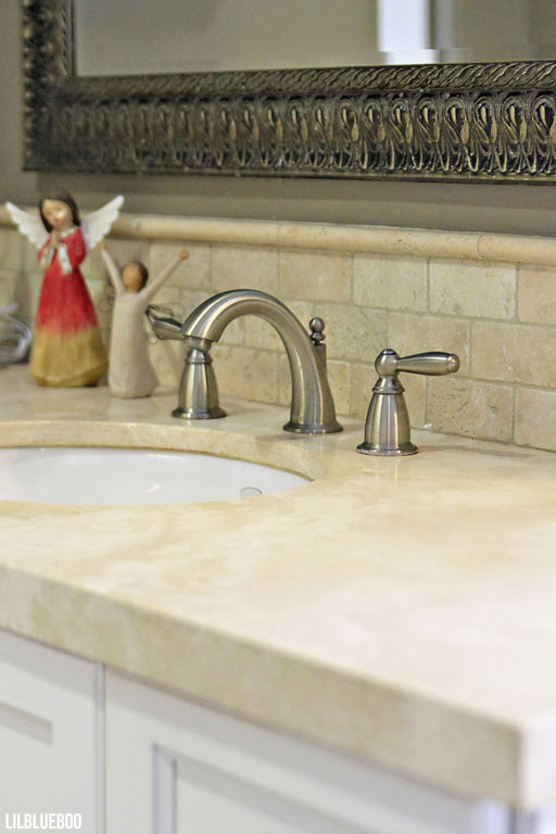 The Master Bathroom - Travertine Scrap Countertops and Backsplash - Master Bath decor ideas via lilbliueboo.com #masterbath #bathdecor