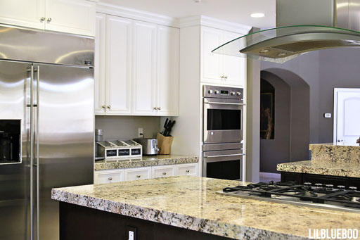 Our renovation - Kitchen with White Cabinets and Stainless Steel hood via Ashley Hackshaw / Lil Blue Boo