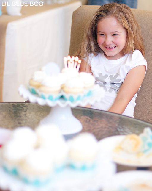 Blowing out the candles! Frozen Winter Snowflake Birthday Party via Ashley Hackshaw / lilblueboo.com #frozen