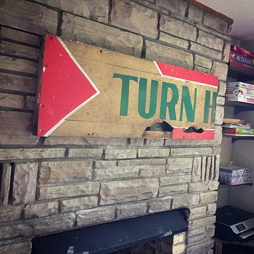 Artwork above my fireplace using a reclaimed sign