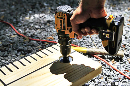How to cut a hole into a piece of wood using a drill
