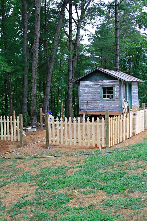 how to build a picket fence on a hill