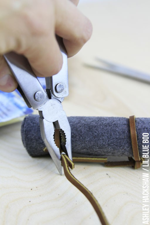 Using Wire to secure the leather straps on bedroll
