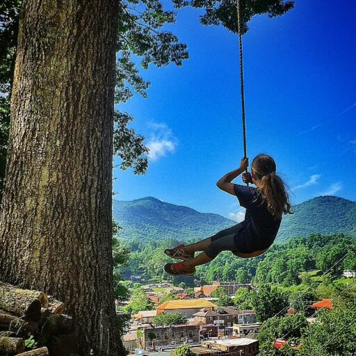 Swinging over downtown Bryson City, NC in Summer - original tree swing