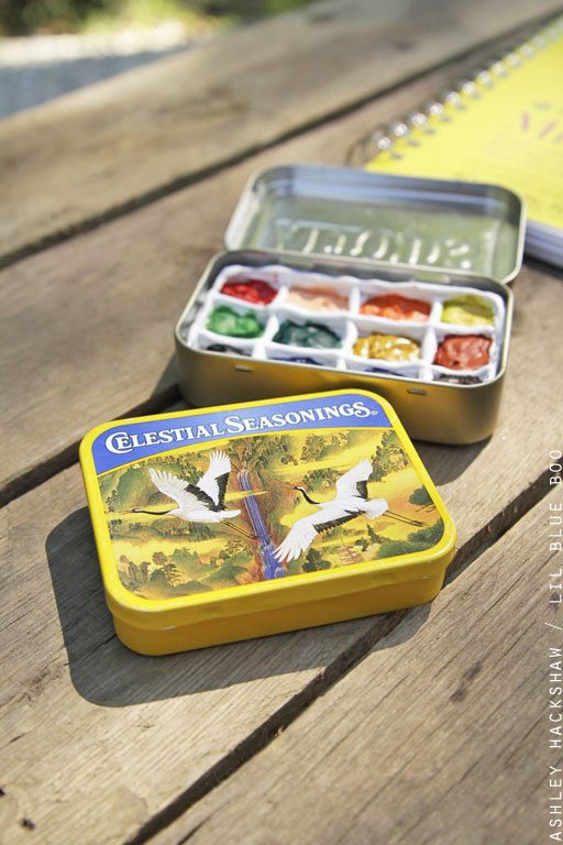 A pocket-sized travel watercolor paint box made from altoid tins and tea boxes