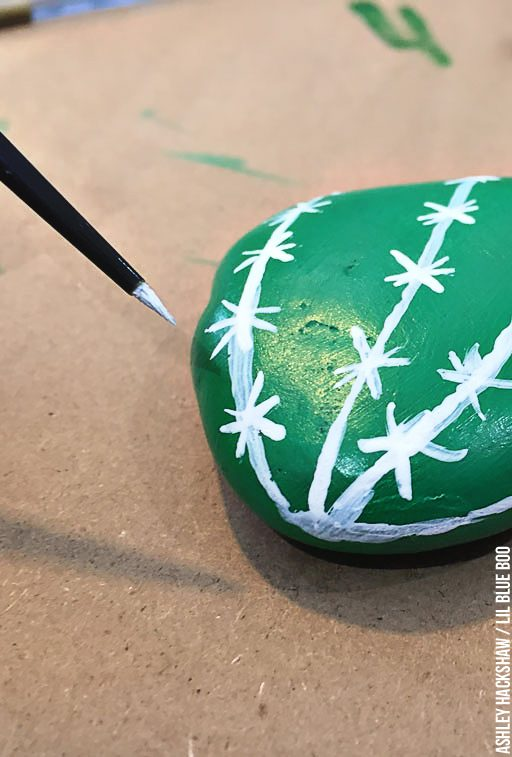 Hand painting rocks to look like a cactus or vegetable