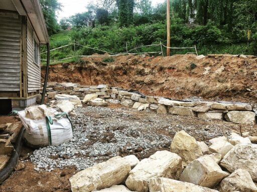 Farmhouse Renovation Rock Retaining Wall - Sixty-One Park Farmhouse