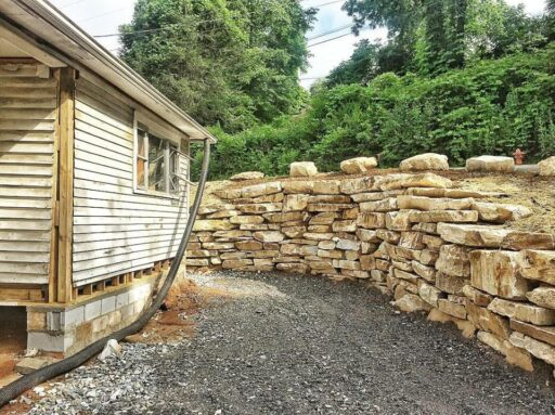 Farmhouse Renovation Rock Retaining Wall - Sixty-One Park Farmhouse