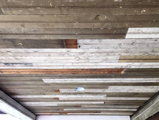 Reclaimed breadboard ceiling for the the porch