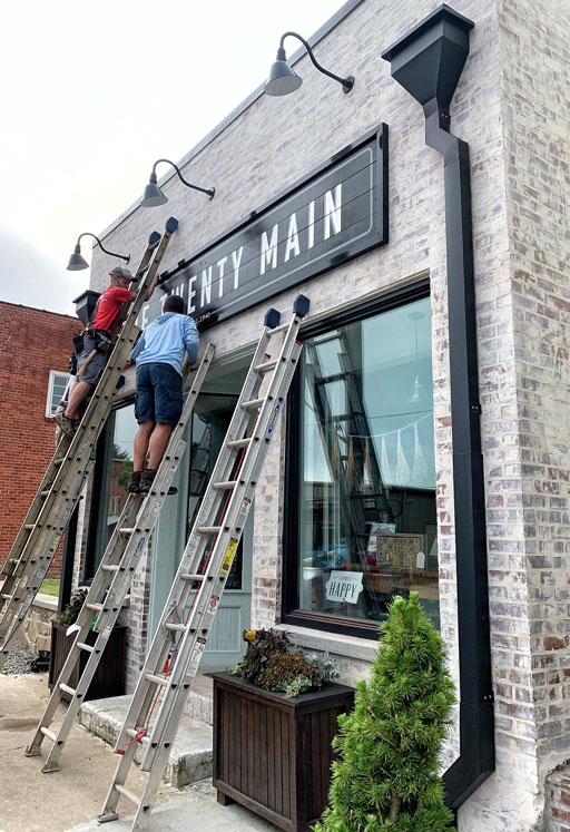 Attaching a sign to a store front - Store Front sign ideas