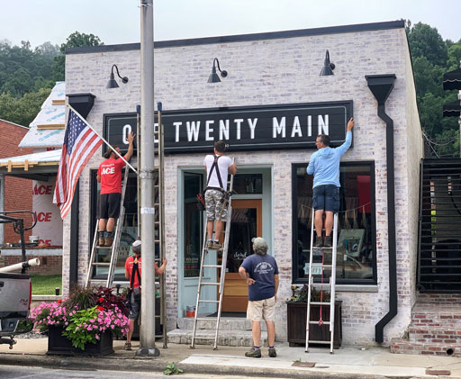 A Hand Painted Store Front Sign for One Twenty Main